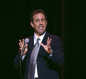 Jerry Seinfeld on stage.